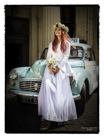 Retro 70's wedding dress and police panda car for hire